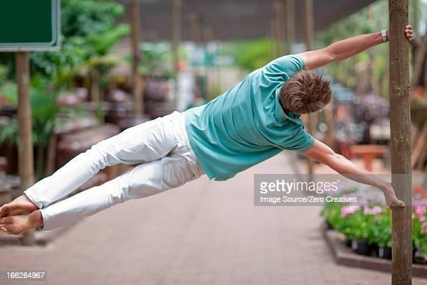 Man swinging from pole