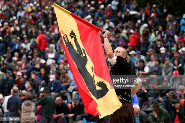 A man swings a canton Berne flag during the Alpine Wrestling Festival BruenigSchwinget at the top of the Bruenig Pass on July 27 2014 in Meiringen...
