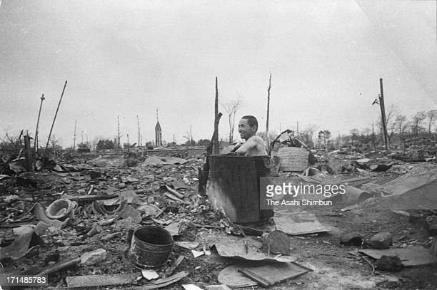 A man take a bath at ruined Tokyo after the bombing of Tokyo in March 1945 in Tokyo Japan