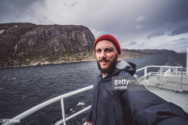 man take a selfie on sailing vessel - passenger craft stock pictures, royalty-free photos & images