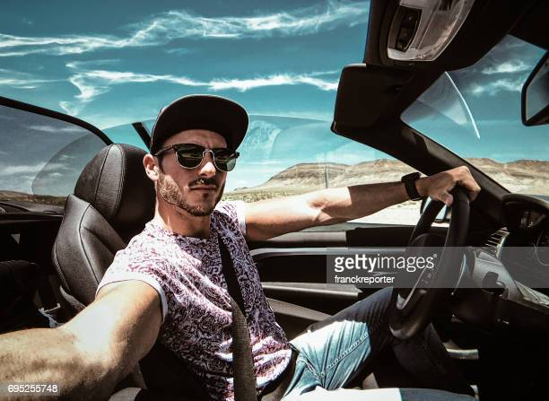 man take a selfie while he is driving - convertible stock pictures, royalty-free photos & images