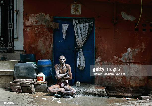 A man takes a bath on the side of the street on June 1 in New Delhi India Inadequate access to safe water sanitation poor quality housing with bad...
