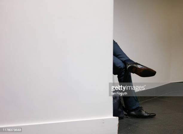 A man takes a break after the speeches come to an end on the third day of the Conservative Party Conference at Manchester Central at Manchester...