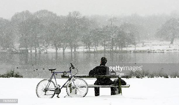 A man takes a break from cycling during snowfall over Richmond Park on February 8 2007 in London EnglandTravel chaos grips Southern England as heavy...
