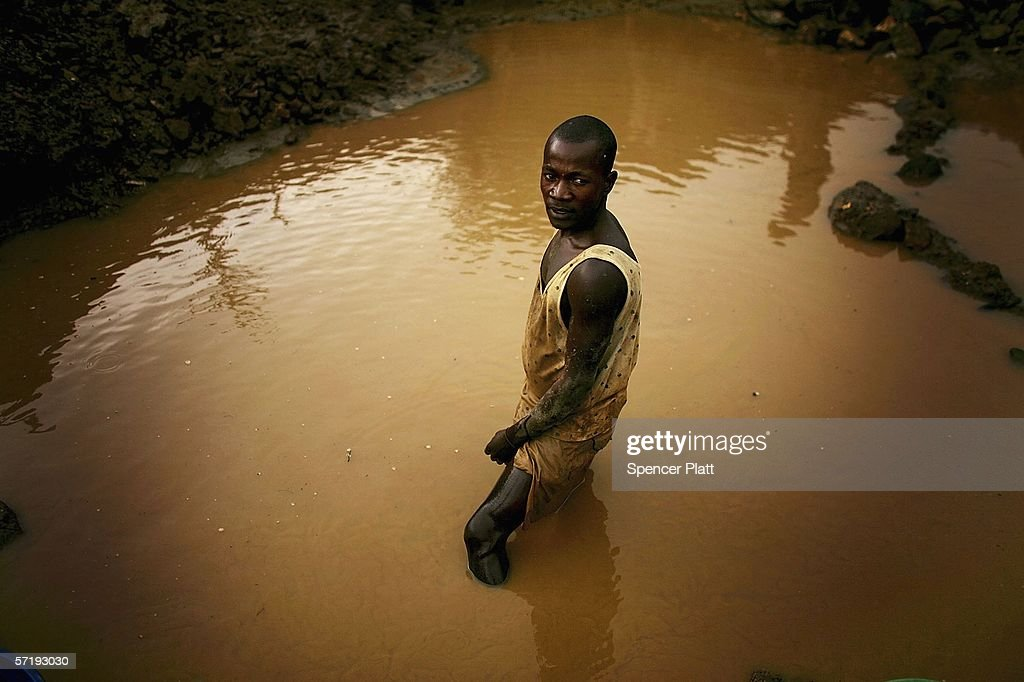 A man takes a break from shoveling in a pool of water searching for gold at a mine March 27, 2006 in Mongbwalu, Congo. Thousands of Congolese scrape together meagre livings from mining. Gold and other mineral deposits, which are numerous in the volatile north-east of the country, have become a catalyst to much of the conflict in Congo. The Democratic Republic of Congo (DRC), a country that loses an estimated 1,400 people per day due to war since 1998, is struggling to hold Presidential elections this summer. The volatile East of the country, which is situated hundreds of miles from the capital Kinshasa, has been the focal point of continued violence. Numerous militias and warlords have vied for control of the mineral rich eastern Congo for decades, creating instability and continued bloodshed.