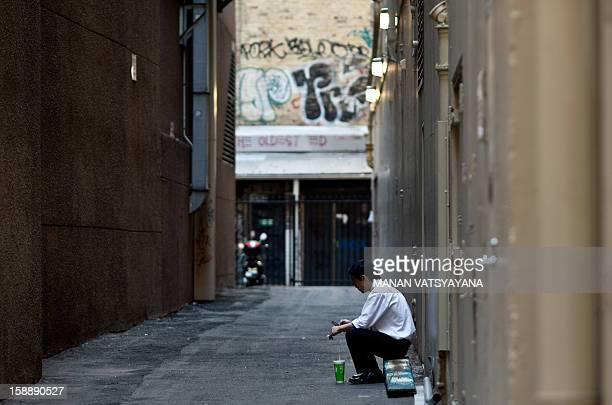 A man takes a break from work in an alley in Sydney on January 3 2013 Sydney's ranking has consistently been placed in the top 10 liveable cities in...
