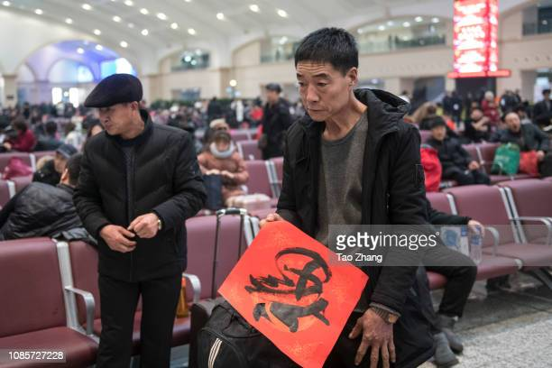A man takes a chinesefuat Harbin Railway Station on January 21 2019 in Harbin ChinaAbout 299 billion trips are expected to be made during the 2019...