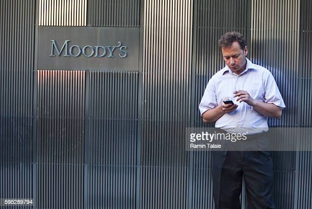 A man takes a cigarette break outside of Moody's Corporation headquarters in Lower Manhattan NY on September 9 2011 Moody's is a credit rating agency...