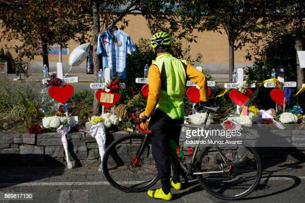 A man takes a look at the makeshift memorial for victims of Tuesday's terrorist attack along a bike path in lower Manhattan on November 3 2017 in New...
