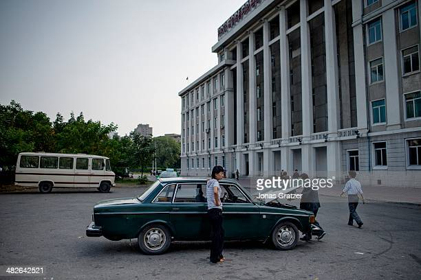 A man takes a look under the hood of an old Volvo 144 from the 70's North Korea is still in debt with Sweden for these old cars among other things 60...
