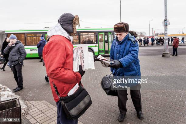 Man takes a pamphlet of a supporter of the Communist Party in the streets of Moscow Russia on 14 March 2018 during the presidential campaign of...