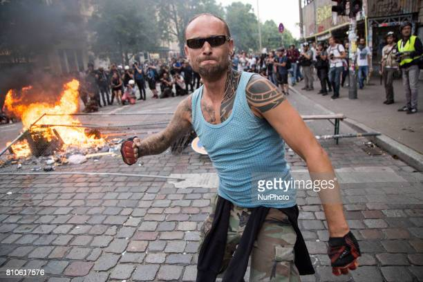 Man takes a part in riots in St Pauli district during G 20 summit in Hamburg on July 8 2017 Authorities are braced for largescale and disruptive...