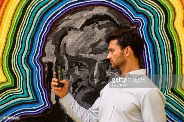 A man Takes a photograph in front of 'Peter Hitchener Channel 9 Melbourne' by Bob Parks during a press preview of the 250th Summer Exhibition at...