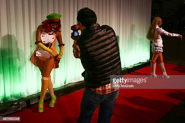 A man takes a photograph of a cosplayer dressed as a video game character during Game Party Japan 2015 at the Makuhari Messe on January 31 2015 in...