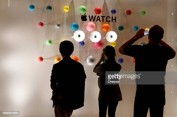 A man takes a picture during the new Apple Watch display during an Apple special event at Colette store on September 30 2014 in Paris France Apple...