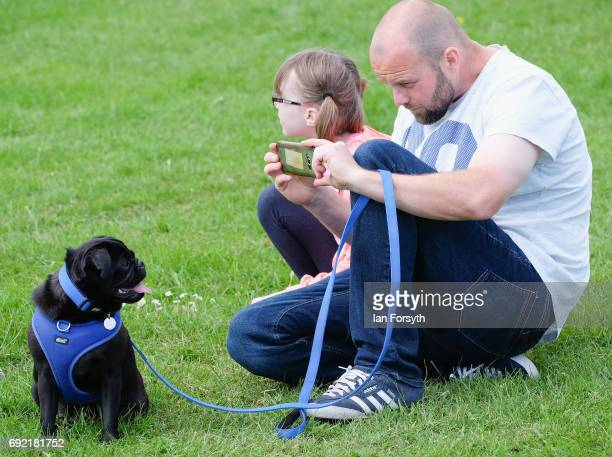 A man takes a picture of his dog as he takes part in the Great North Dog Walk on June 4 2017 in South Shields England Founded in 1990 by former...