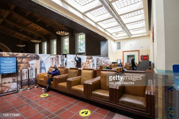Man takes a picture of the blocked area of the main gallery from the waiting area of the Union Station, downtown L.A. Where part of the Oscars...