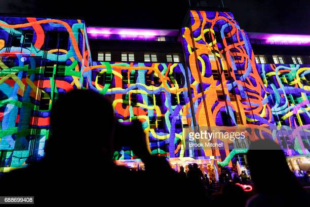 A man takes a picture of the light display at the Museum of Contemporary Art on May 26 2017 in Sydney Australia Vivid Sydney is an annual festival...