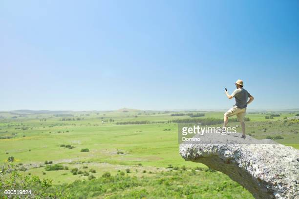 man takes a picture of the view - un solo hombre stock photos and pictures