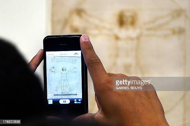 A man takes a picture of the Vitruvian Man by Leonardo da Vinci on August 29 2013 in Venice Fiftytwo drawings by Renaissance genius Leonardo da Vinci...