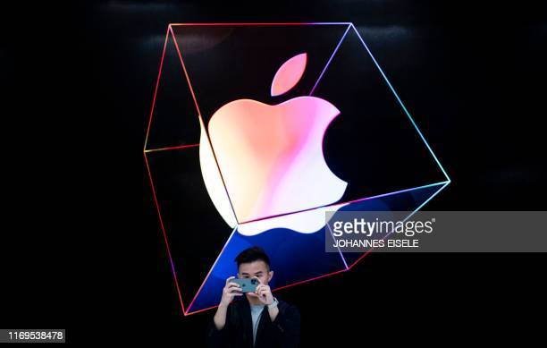 TOPSHOT A man takes a picture with a new iPhone 11 inside the newly renovated Apple Store at Fifth Avenue on September 19 2019 in New York City