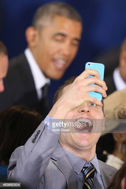 A man takes a selfie as President Barack Obama walks past after the president delivered a speech at the Gwendolyn Brooks College Preparatory Academy...