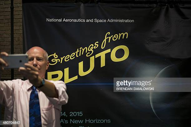 A man takes a selfie at the Johns Hopkins University Applied Physics Laboratory July 14 2015 in Laurel Maryland The New Horizons interplanetary space...
