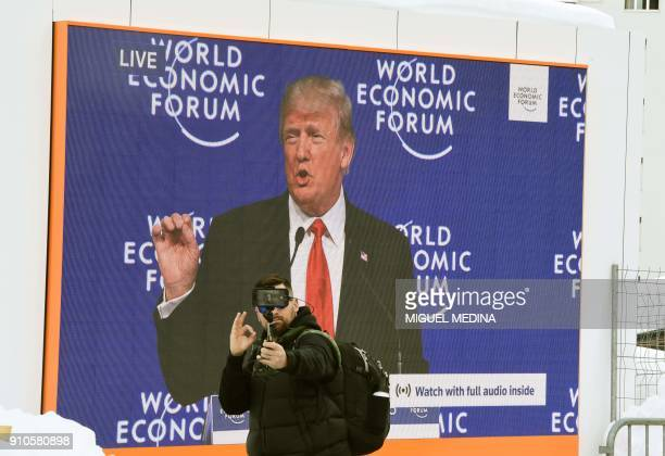 A man takes a selfie during the speech of US President Donald Trump on January 26 2018 at the Davos Congress Centre the venue of the annual World...