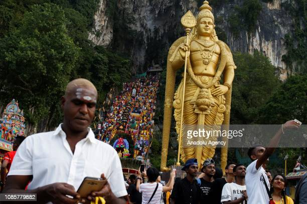 A man takes a selfie in front of Lord Murugan statue at Batu Caves Temple during the festival of Thaipusam in Batu Caves Kuala Lumpur Malaysia on...