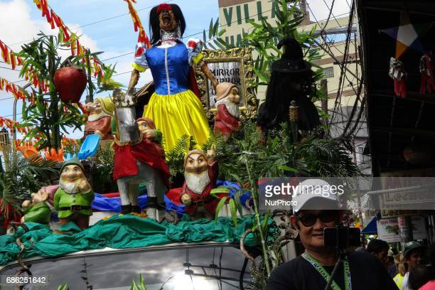 A man takes a selfie with a float during the La Loma Lechon festival in Quezon City east of Manila Philippines on Sunday May 21 2017 The festival...