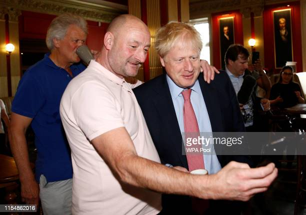 A man takes a selfie with Boris Johnson a leadership candidate for Britain's Conservative Party as he visits Wetherspoons Metropolitan Bar to meet...