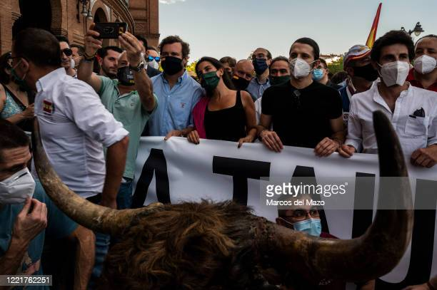 Man takes a selfie with far right party VOX members, Rocio Monasterio and Ivan Espinosa de los Monteros, during a protest in support of bullfighting...