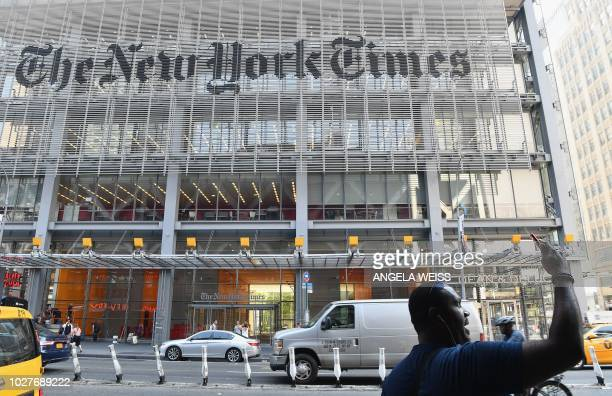 Man takes a selfie with his smartphone in front of the New York Times building on September 6, 2018 in New York. - A furious Donald Trump called...