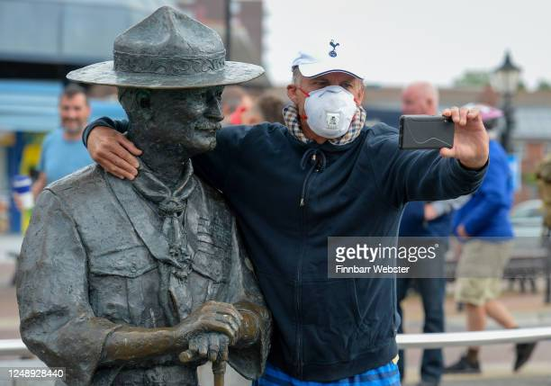 A man takes a selfie with the Lord BadenPowell statue on June 11 2020 in Poole United Kingdom The statue of Robert BadenPowell on Poole Quay is to be...