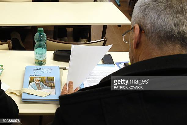 A man takes a theology training class for future imams and clerics at the AlGhazali institute of the Grand Mosque of Paris on December 19 2015 / AFP...