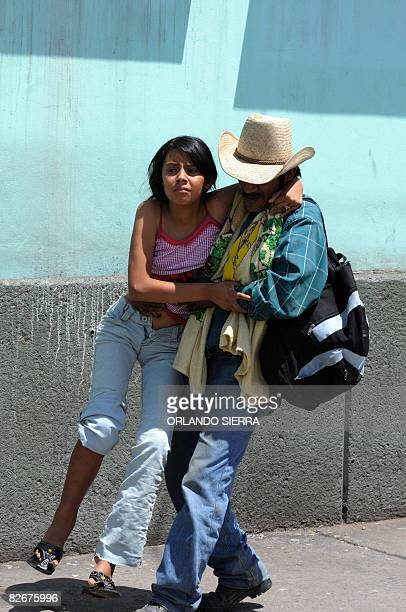Man takes away from the Hospital Escuela in Tegucigalpa a young girl affected by appendicitis on September 5, 2008. The relatives of patients in...