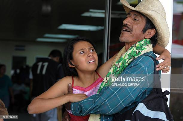 A man takes away from the Hospital Escuela in Tegucigalpa a young girl affected by appendicitis on September 5 2008 The relatives of patients in...