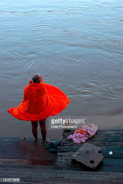 man takes bath in ganges - river ganges stock pictures, royalty-free photos & images