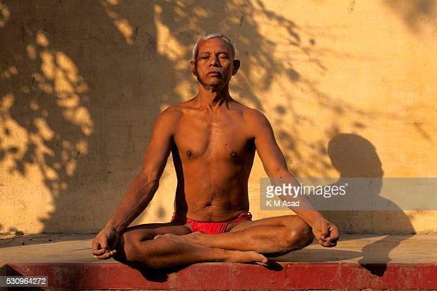 A man takes daily practice in the early morning in Kashi ghat near the Gongha River in Varanasi India November 29 2014 The ancient tradition of...