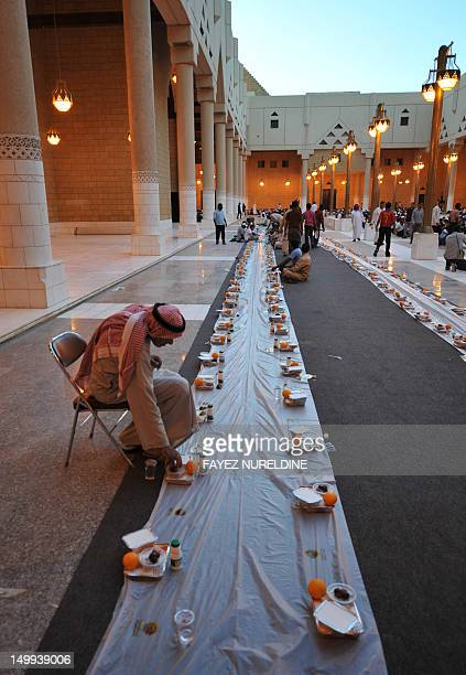 A man takes his place as foreign workers begin to arrive to break their fast outside the Imam Turki bin Abdullah mosque in the Saudi capital Riyadh...