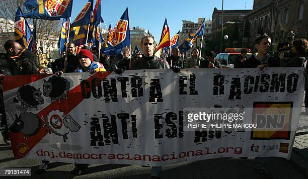 A man takes part in a demonstration against immigration organised by the ultra right party Democracia Nacional in Madrid 20 January 2008 AFP PHOTO /...
