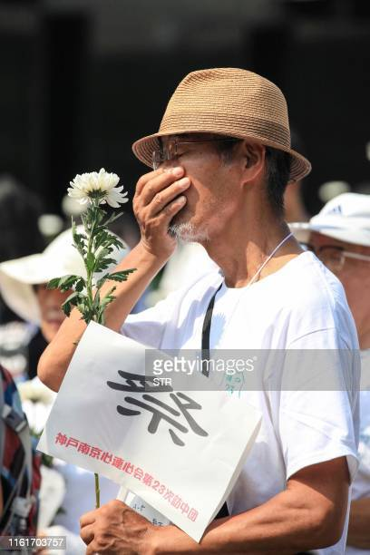 A man takes part in a peaceful assembly to mark the 74th anniversary of Japan's surrender in World War II at the Memorial Hall of the victims in...