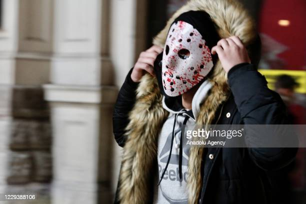 Man takes part in Halloween celebrations in London, United Kingdom on November 01, 2020. People dress and use make-up to make themselves look like...