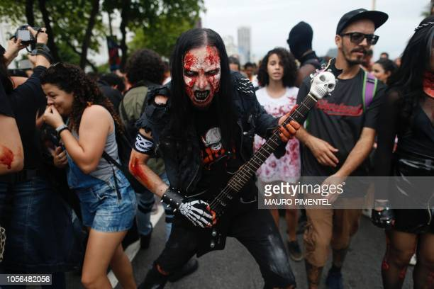 A man takes part in the annual Zombie Walk at Copacabana beach in Rio de Janeiro Brazil on November 2 2018