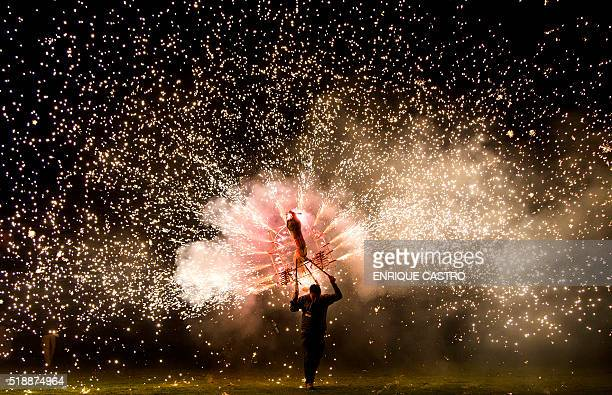 TOPSHOT A man takes part in the International Fireworks Fair in Indaparapeo municipality in Michoacan State Mexico on April 2 2016 AFP PHOTO /...
