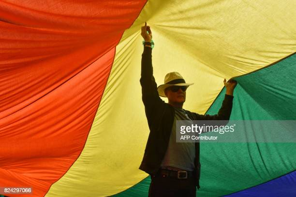 A man takes part in the Namibian Lesbians Gay Bisexual and Transexual community pride Parade in the streets of the Namibian Capitol on July 29 2017...
