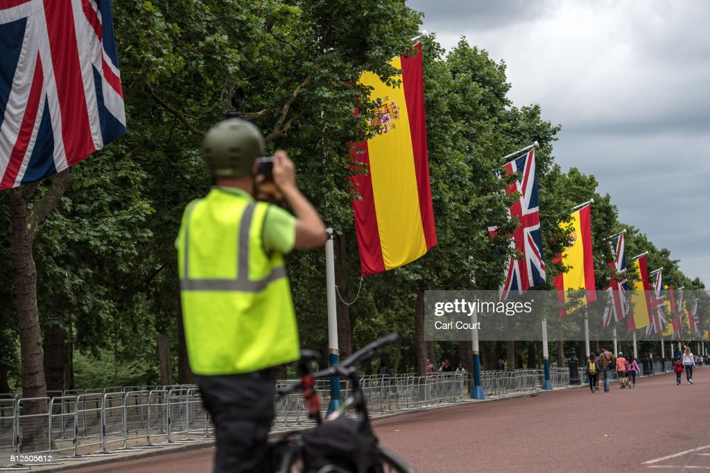 A man takes photographs along The Mall where Spanish flags have been hung alongside Union Flags ahead of the state visit by King Felipe and Queen Letizia of Spain, on July 11, 2017 in London, England. The visit was originally planned from 6th to 8th June but was postponed and will now take place on 12th to 14th July 2017.