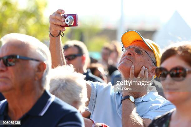 A man takes photographs of the official opening proceedings at Optus Stadium on January 21 2018 in Perth Australia The 60000 seat multipurpose...