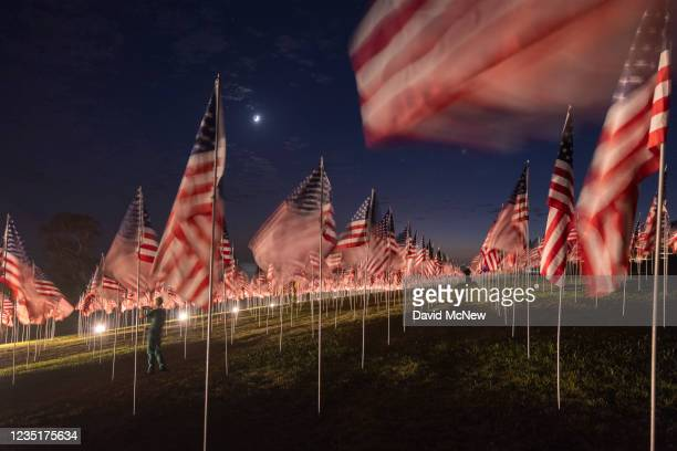 Man takes photos among flags during the 14th annual Waves of Flags on the eve of the 20th anniversary of the September 11 terror attacks in Alumni...