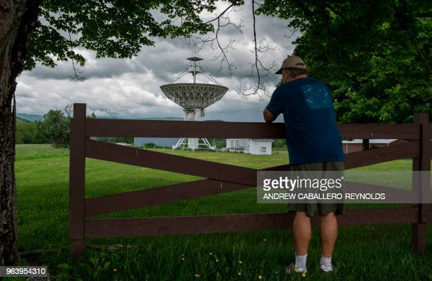 A man takes photos near the entrance to a field of telescopes at The Green Bank Observatory in Green Bank West Virginia on May 28 2018 Green Bank is...